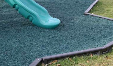 Plastic Colored Mulch and plastic edging around play set